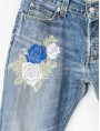 Embroidered and washed jeans